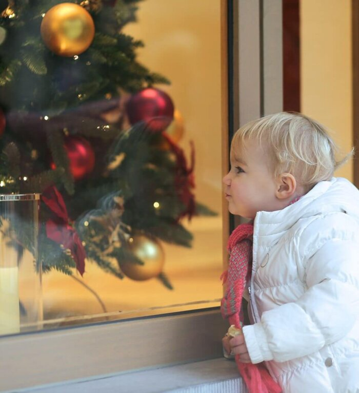Young Girl Looking in Store Front
