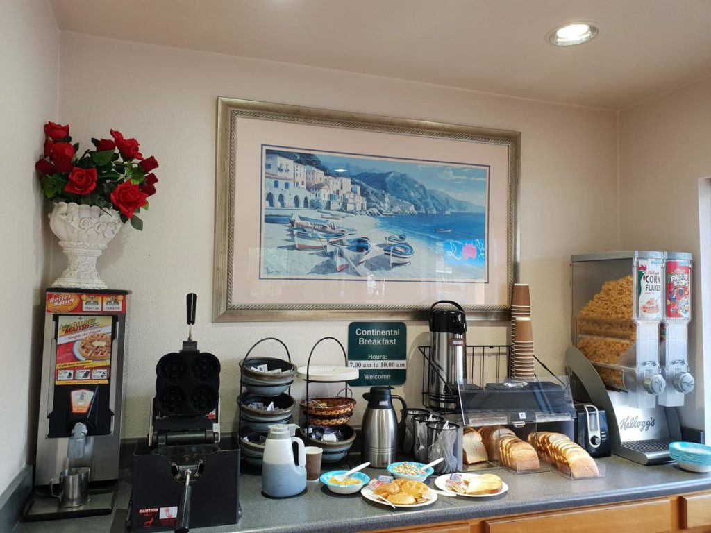 SLO INN continental breakfast with waffle maker, coffee, and cereals in San Luis Obispo
