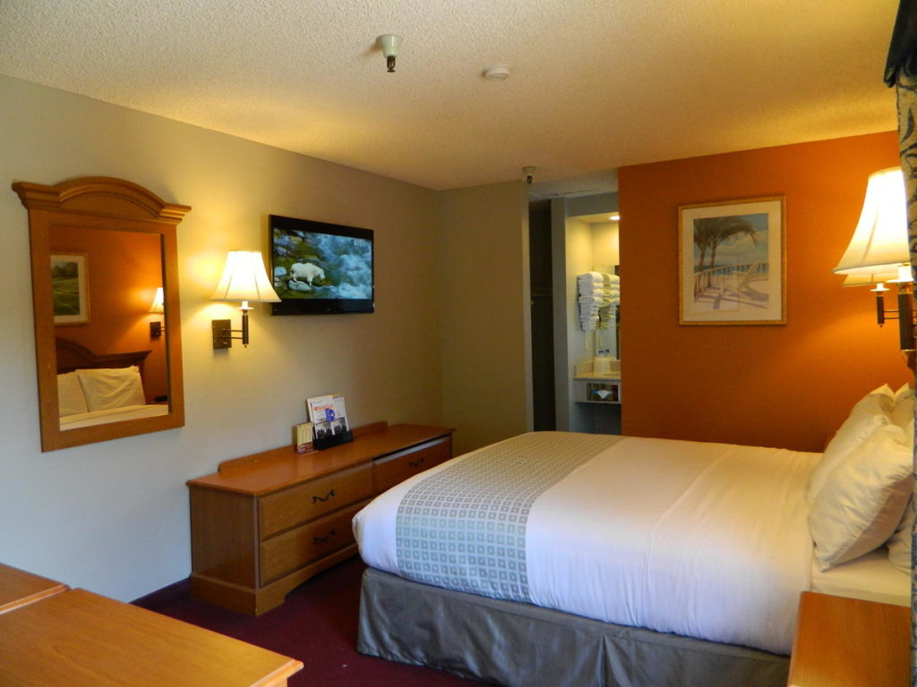 A single bed and TV in a room of the SLO INN in San Luis Obispo.