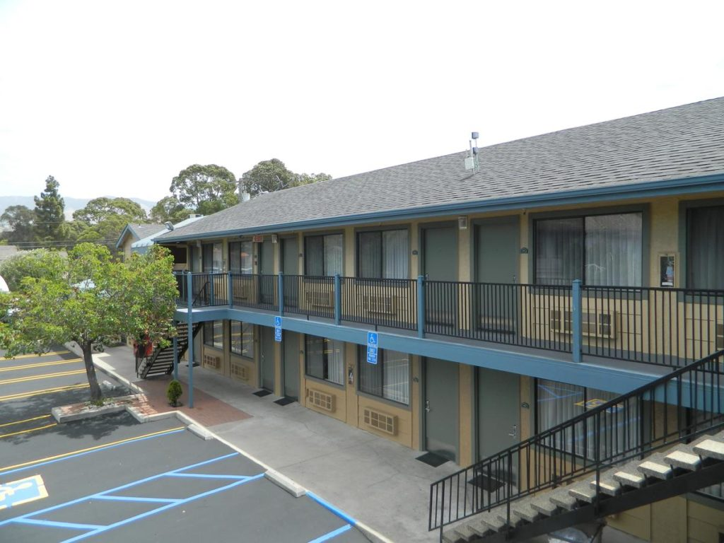 2-story SLO INN exterior balcony and parking lot in San Luis Obispo.