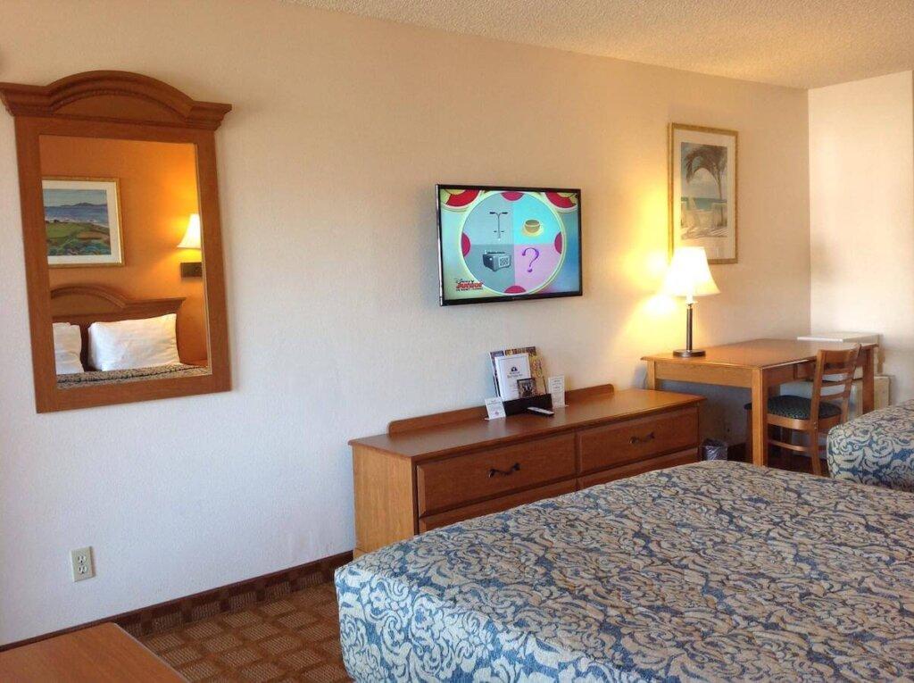 2 beds and a TV in a room of the SLO INN in San Luis Obispo.