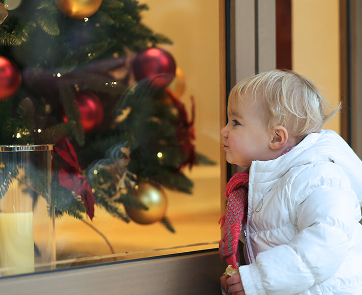 Child looks at a winter time display in San Luis Obispo, CA