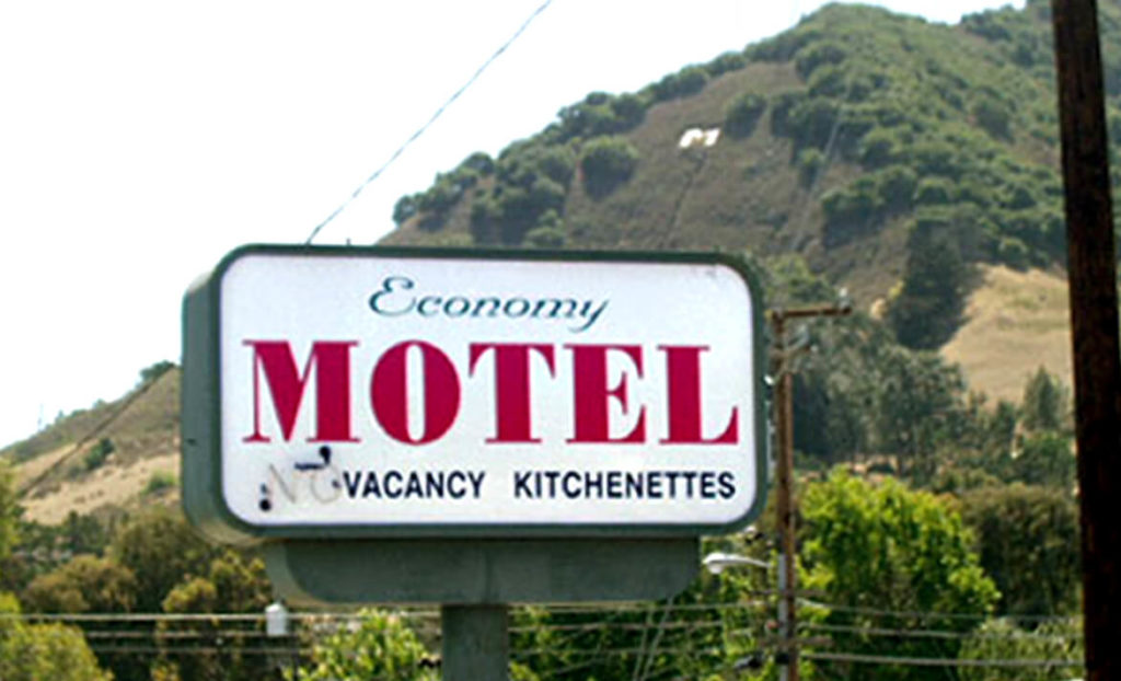 Entry sign of Economy Motel