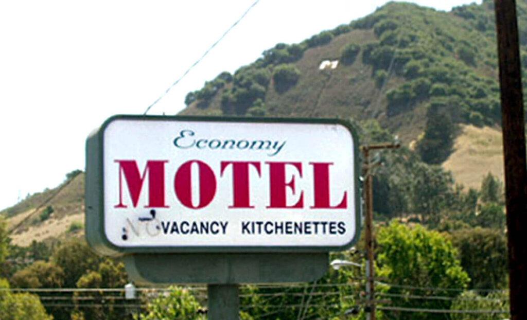 Entry sign of Economy Motel