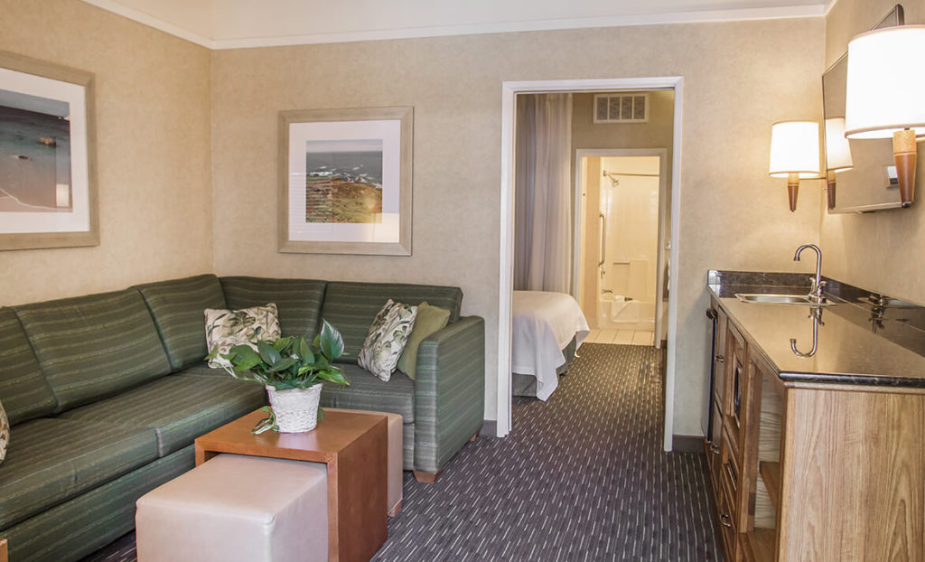Living room and lounge of guest room at Quality Suites Downtown San Luis Obispo