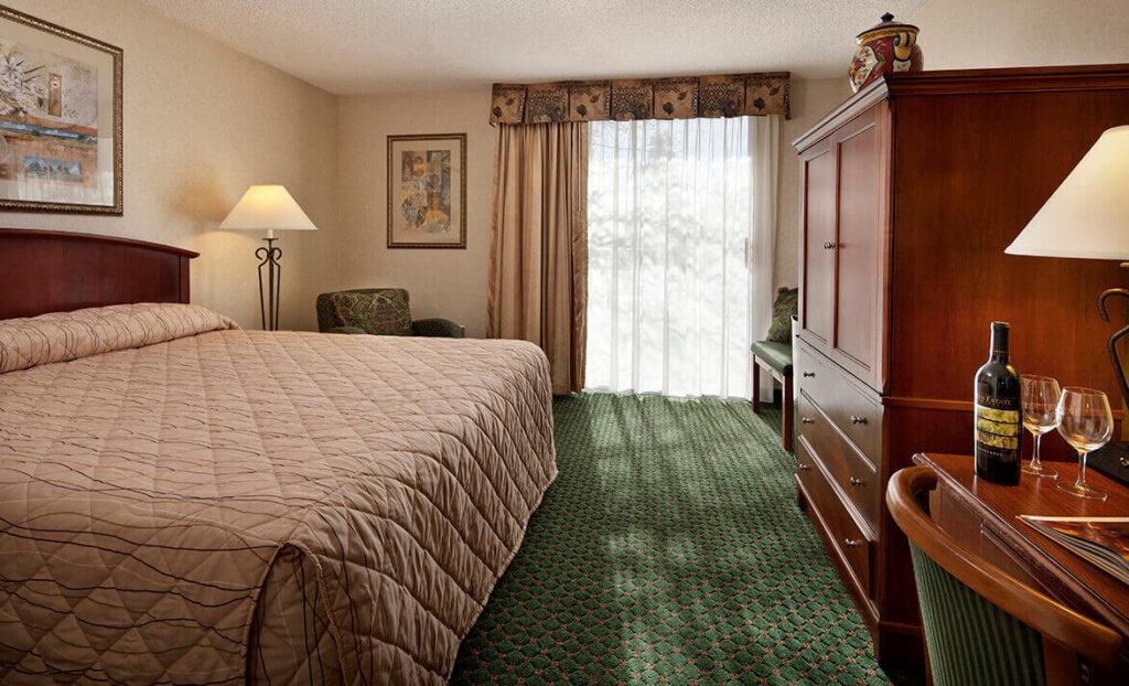 King bed at Rose Garden Inn