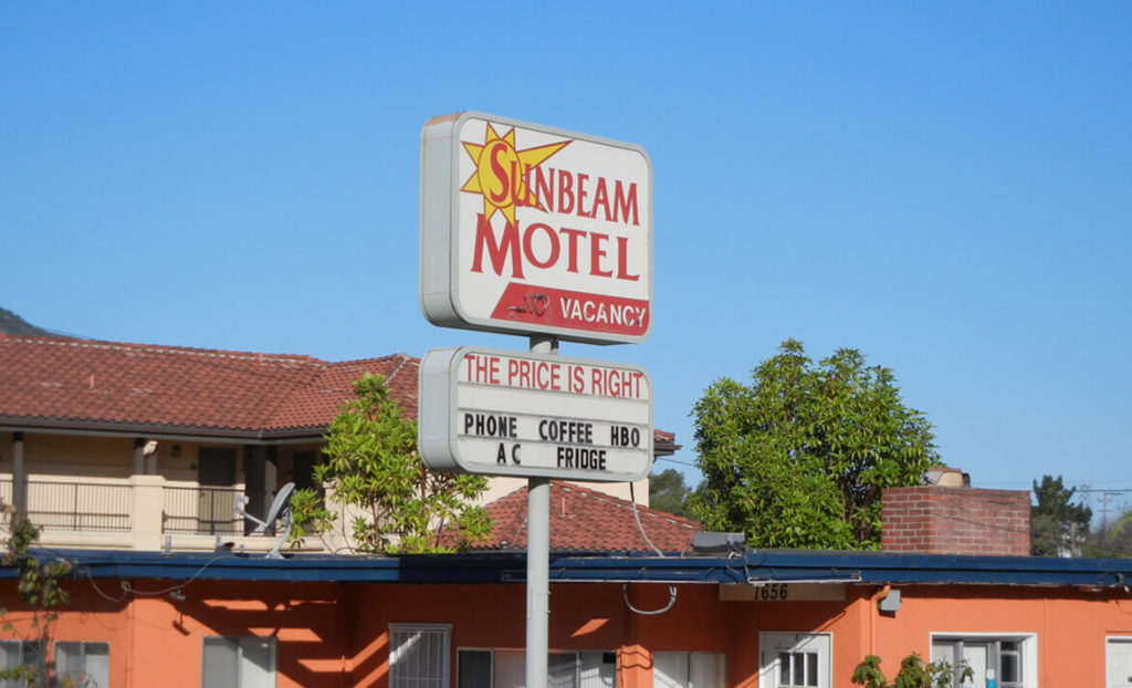 Front entry sign of Sunbeam Motel