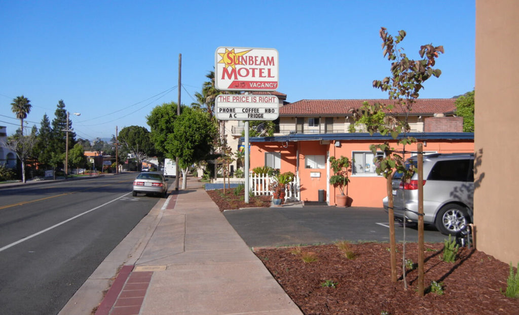 Sunbeam Motel entrance, driveway, and welcome sign