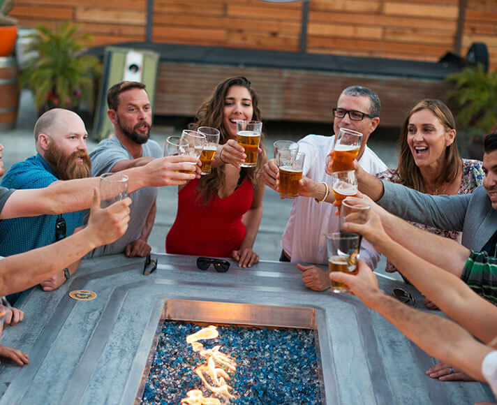 Friends enjoying beer together at Tap It Brewery in San Luis Obispo, California