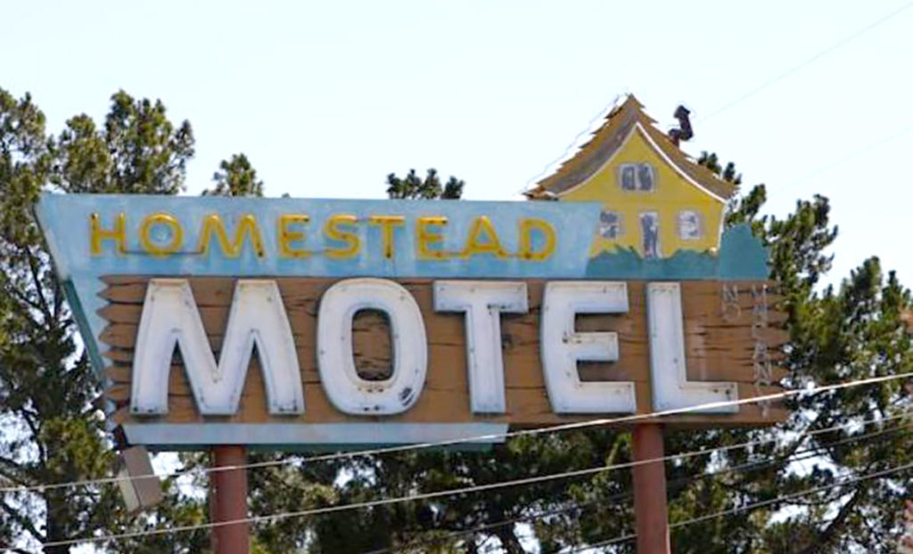 Welcome sign for Homestead Motel