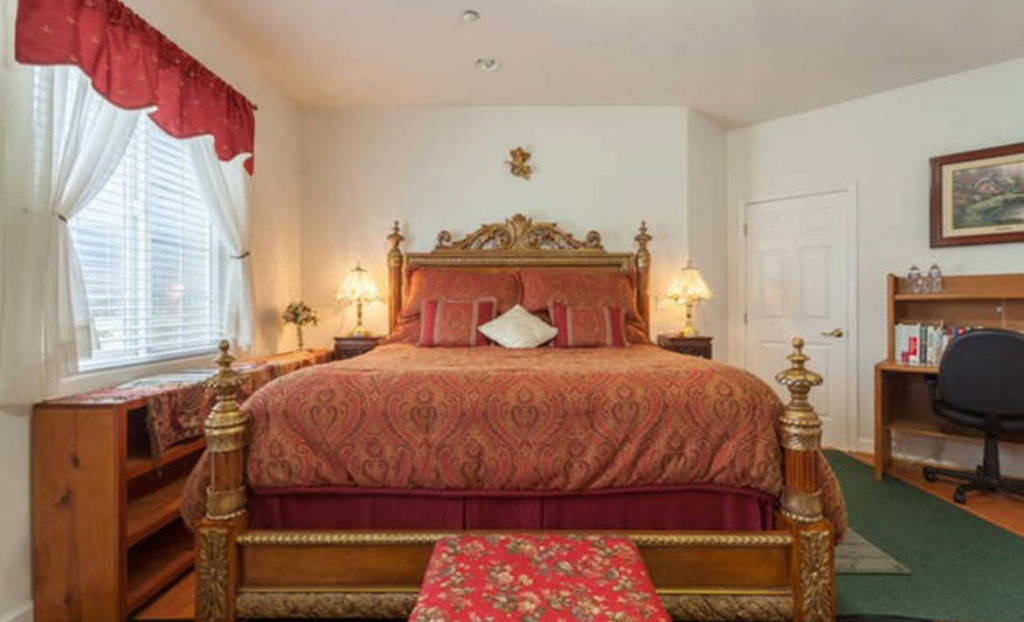 Large bed in room in Oprah's Happiest Town
