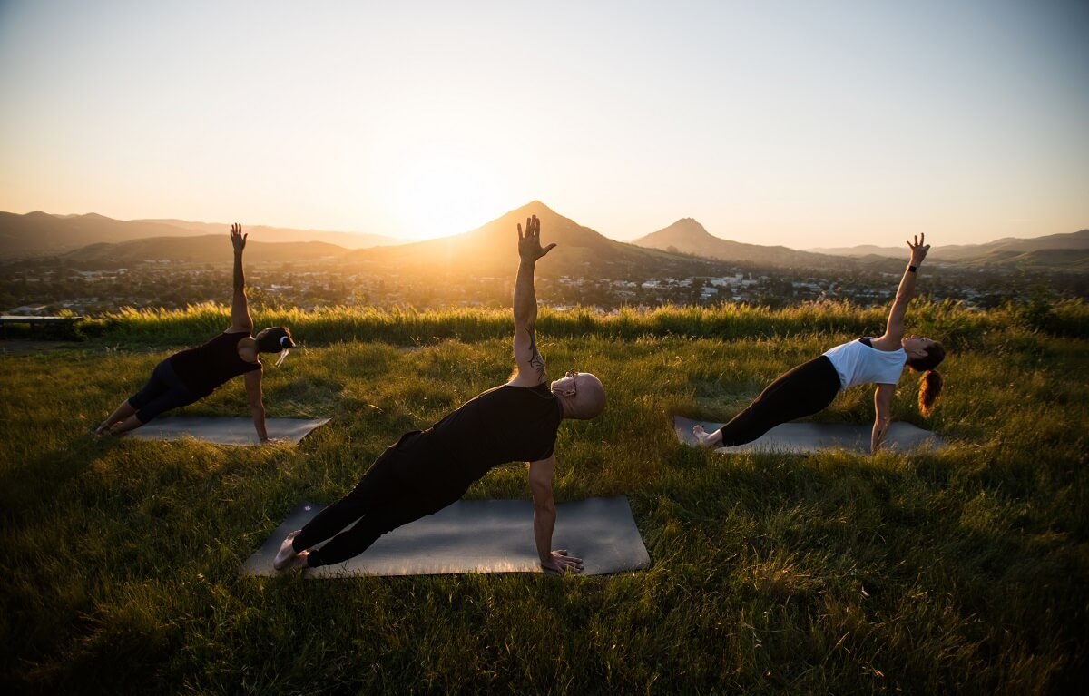 People doing yoga at sunset on Terrace Hill in San Luis Obispo, California