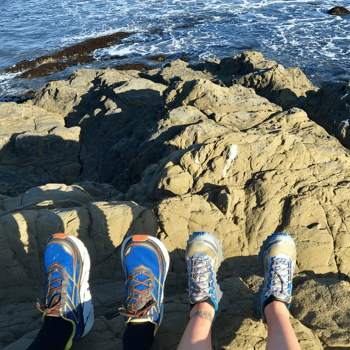 Runner's running shoes on Point Buchon trail in Montana de Oro