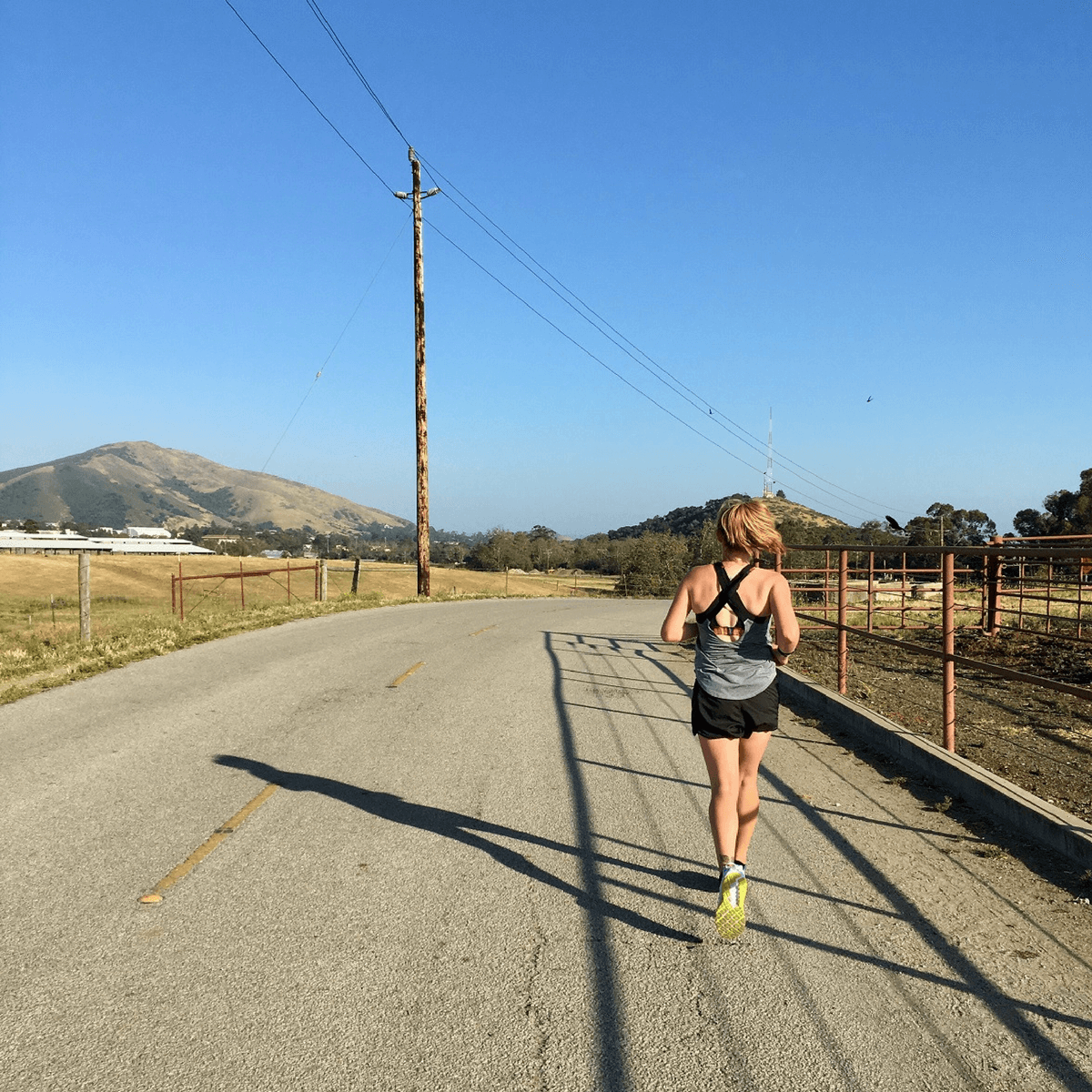 A runner on the Stenner Canyon Trail near Cal Poly