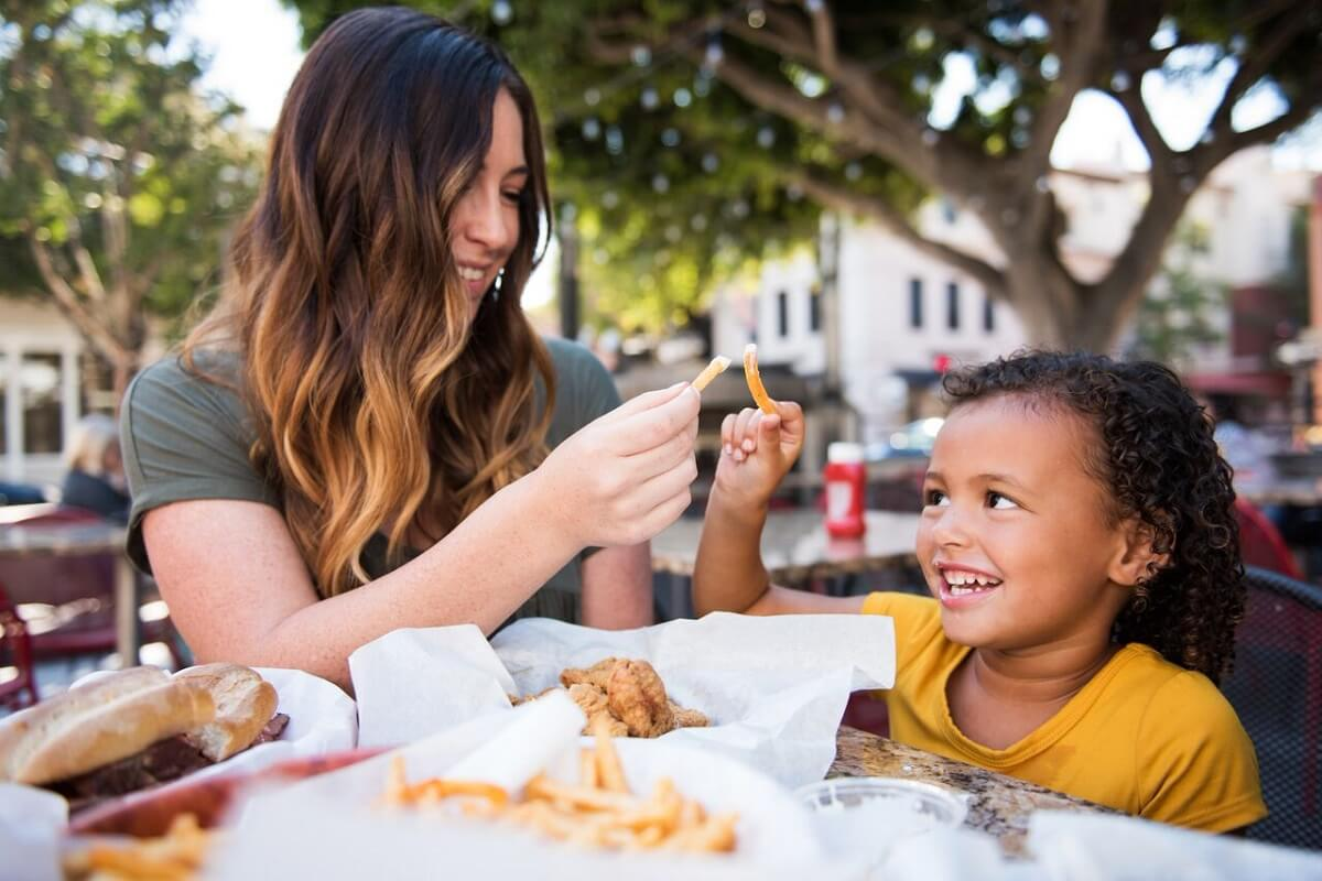 A family enjoying fries at Firestone Grill in SLO