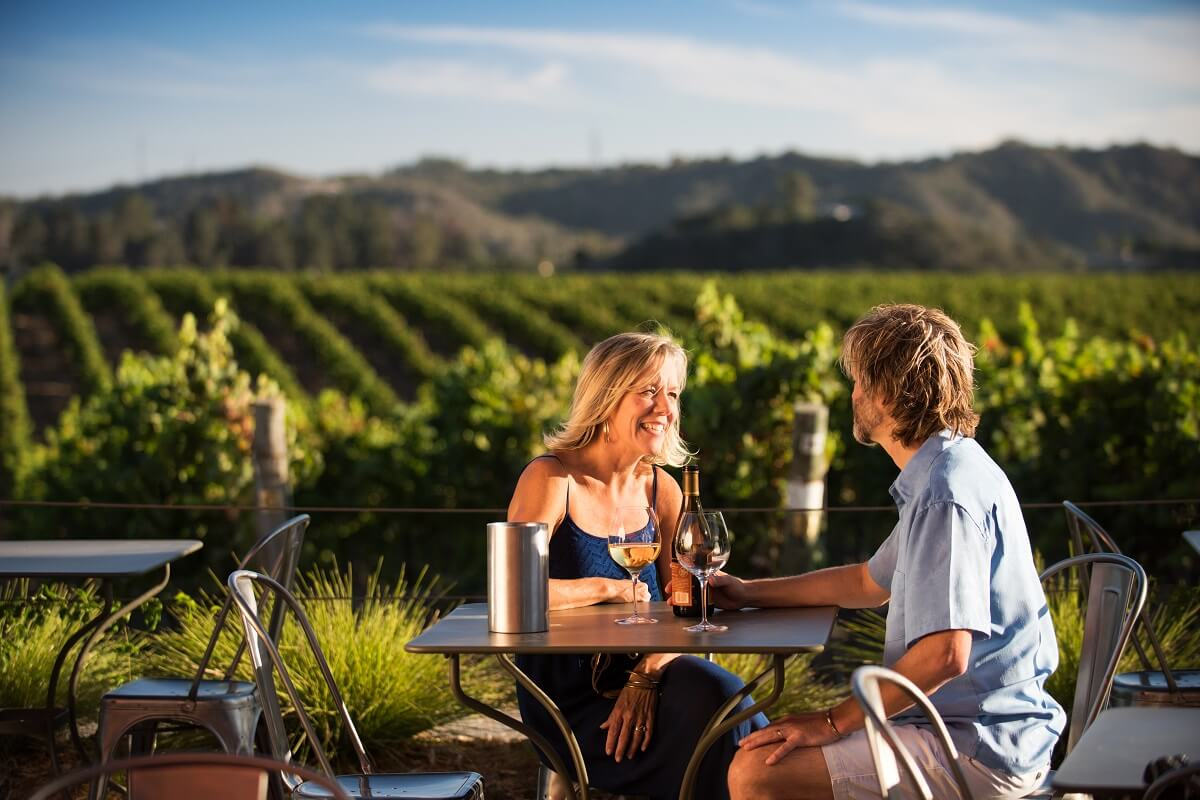 A couple enjoying wine at Chamisal Vineyards in San Luis Obispo
