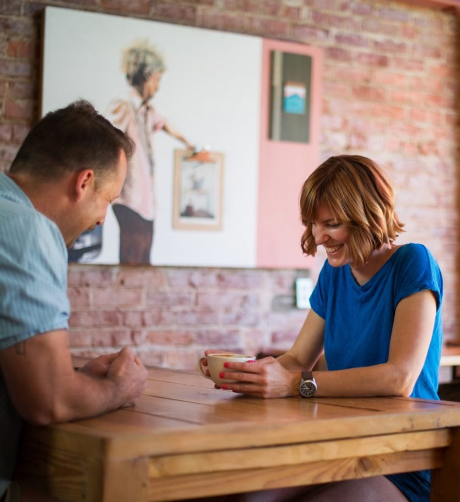 Couple sitting in a coffee shop