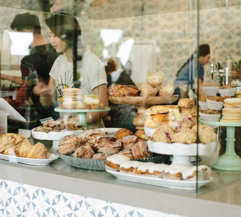 Scout Coffee's pastries behind a pane of glass.