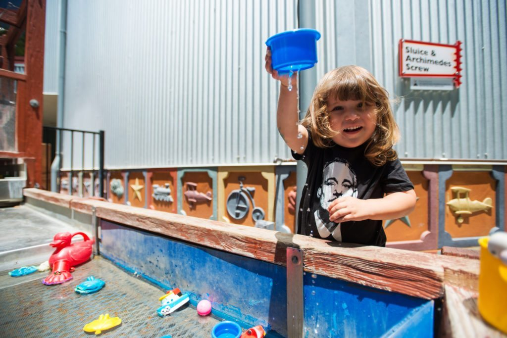 Playing with water outside at the SLO Children's Museum