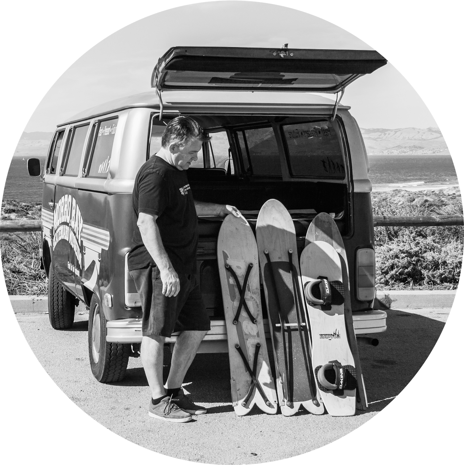 Sandboard pioneer Jack Smith in front of his van with three boards.