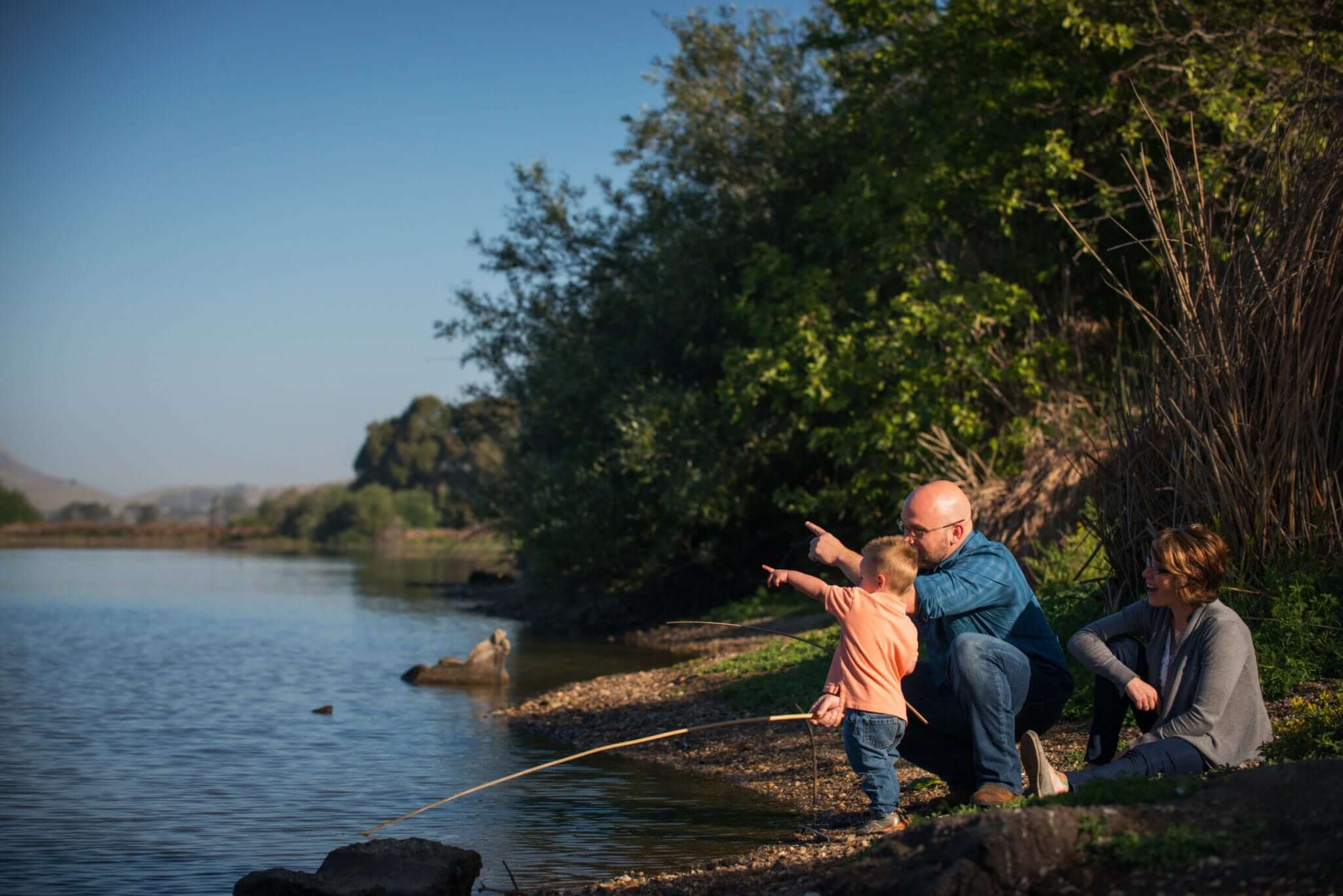 Father and Son Pointing as they fish