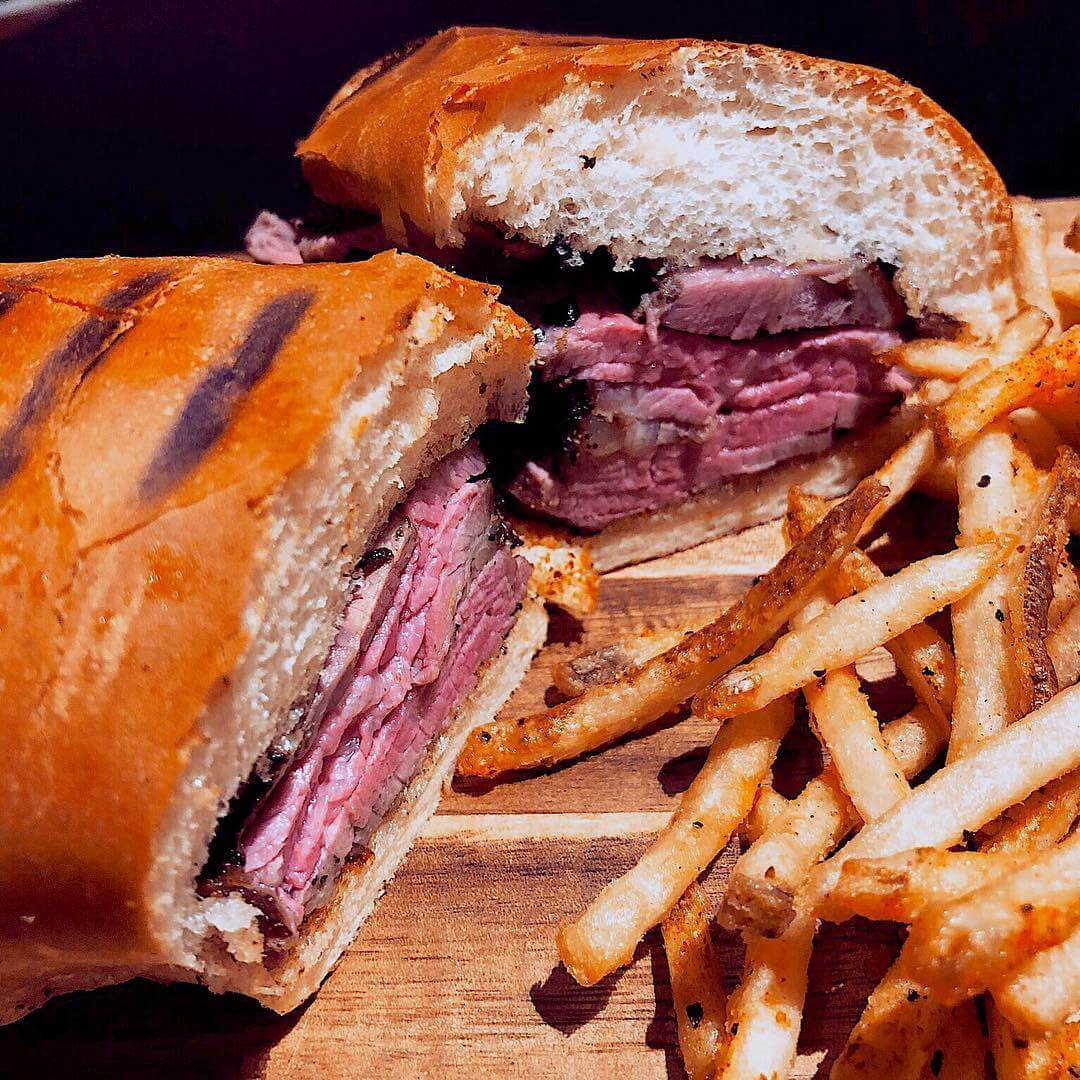 A BBQ Tri-Tip Sandwich with french fries from The Rib Line BBQ in San Luis Obispo