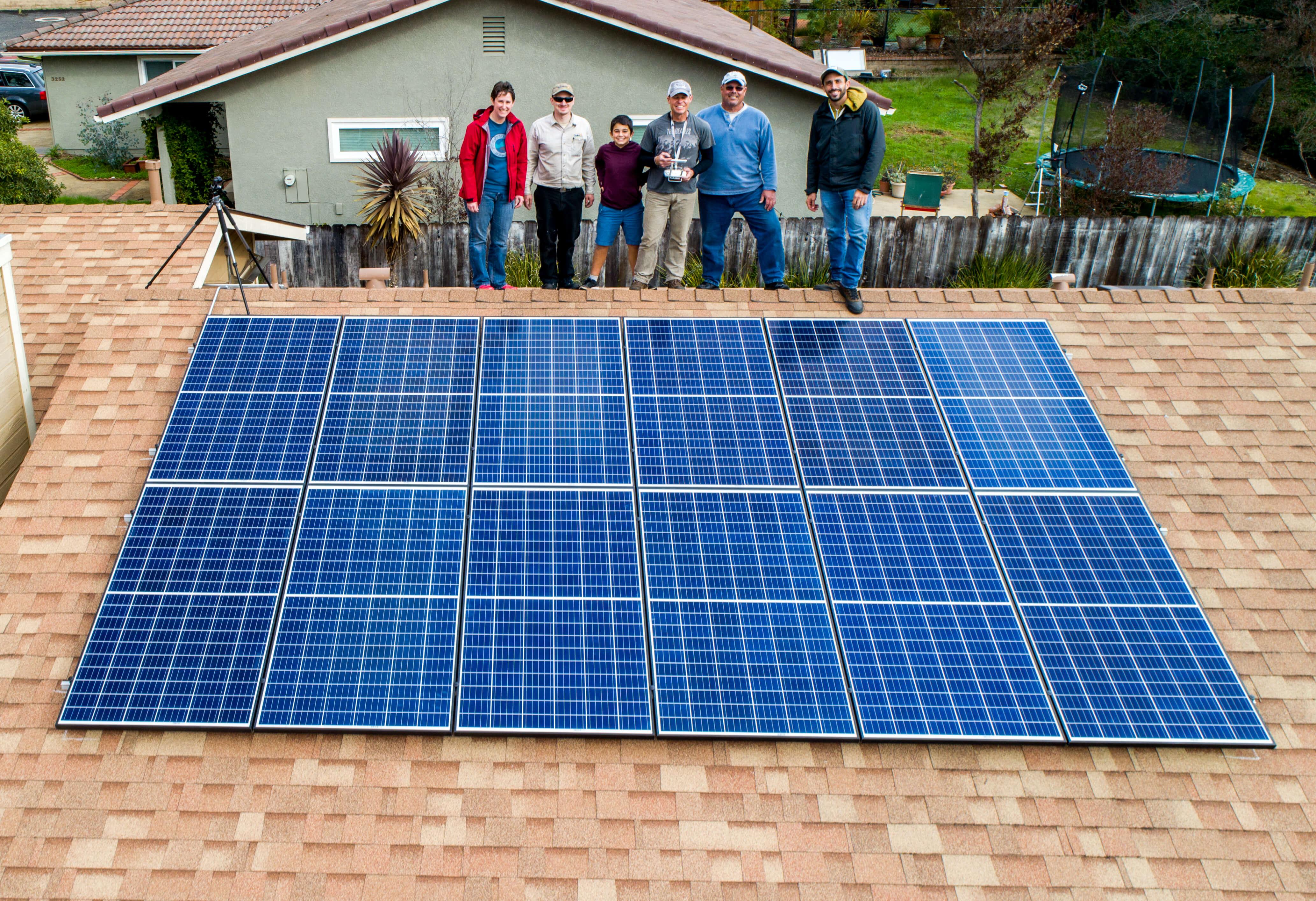 Family admiring their new solar panel on their home in San Luis Obispo