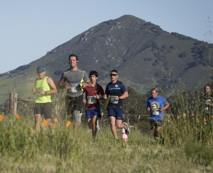 Runners running on SLO backroads