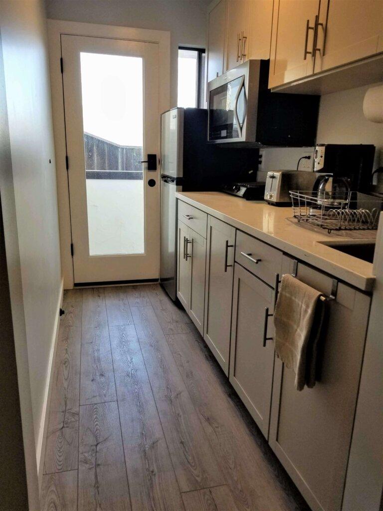 Bluerock Retreat Homestay Kitchen counter and glass door in San Luis Obispo