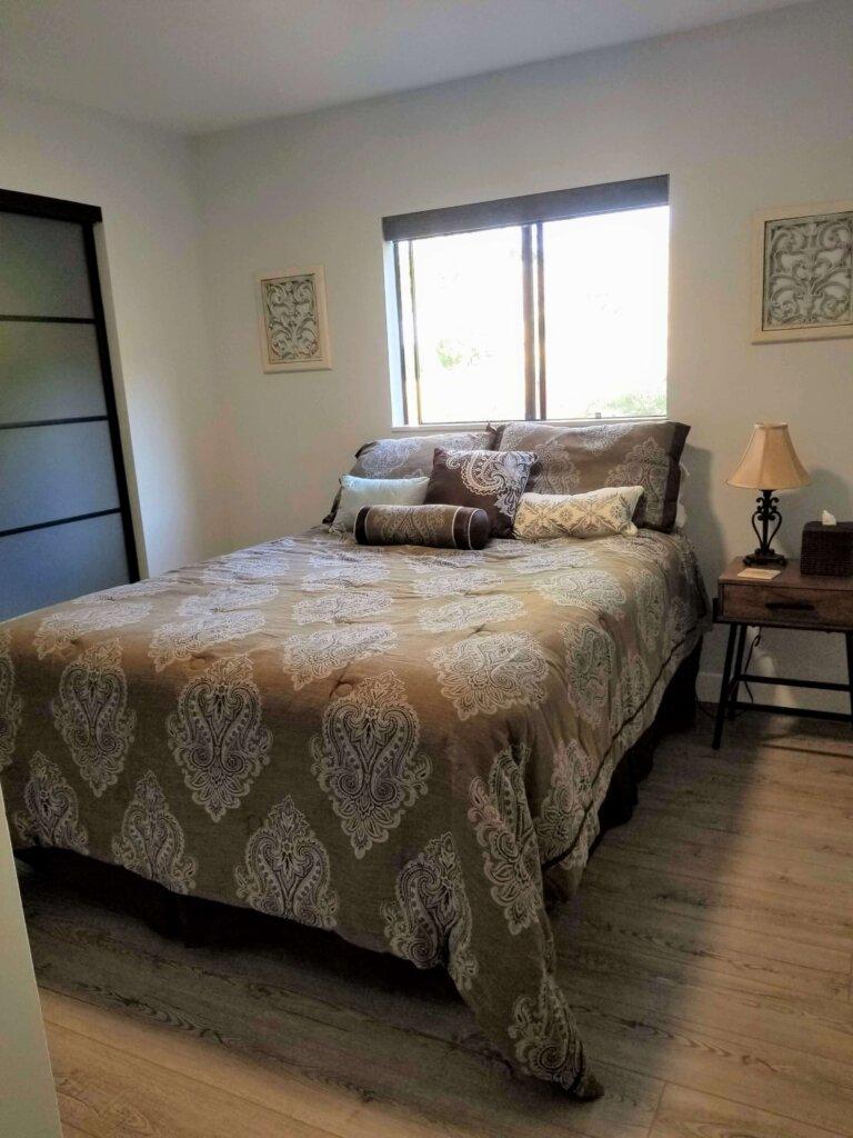 Bluerock Retreat Homestay Bedroom bed and window in San Luis Obispo