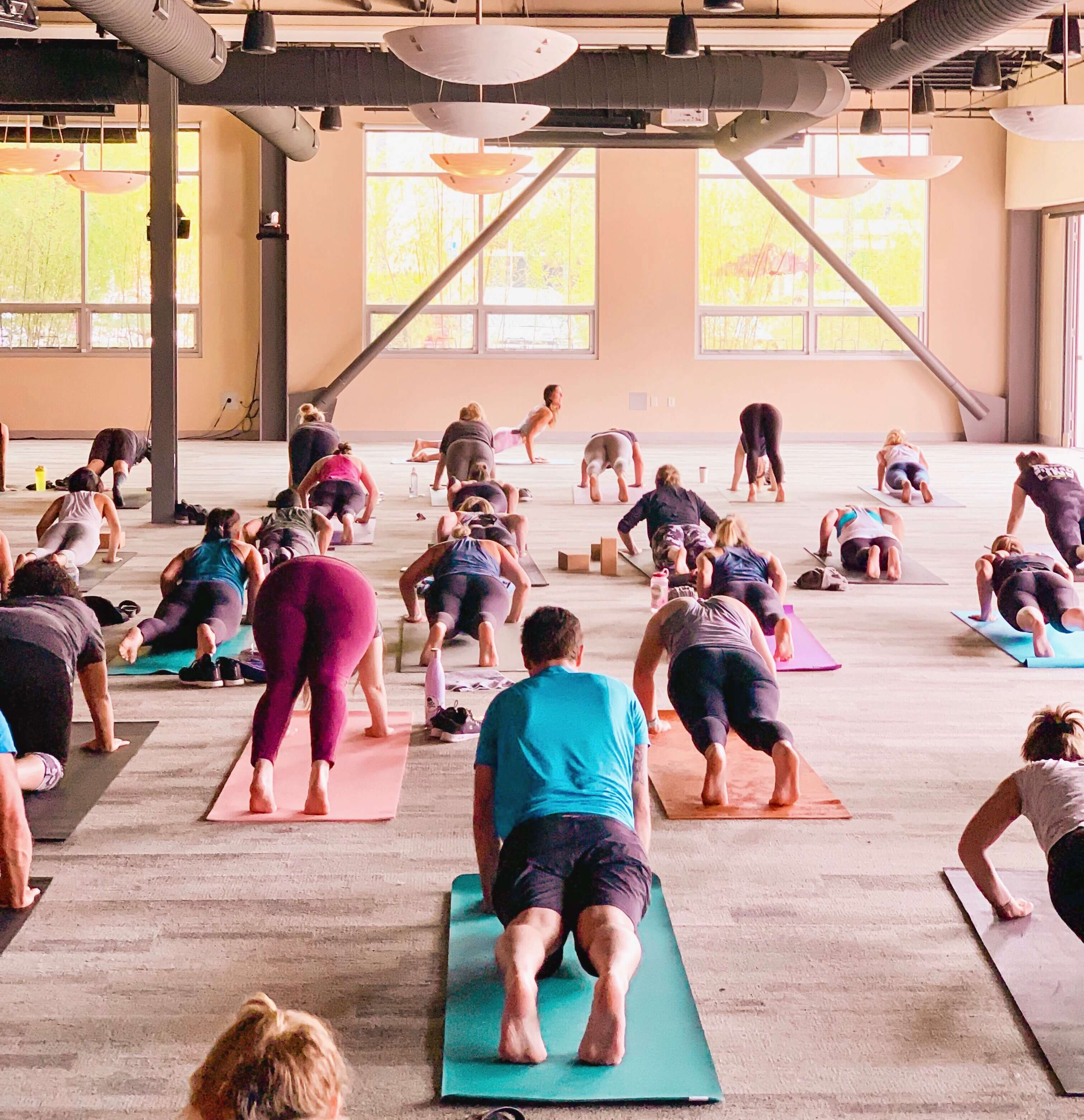 A bright, open yoga class at Mindbody in San Luis Obispo