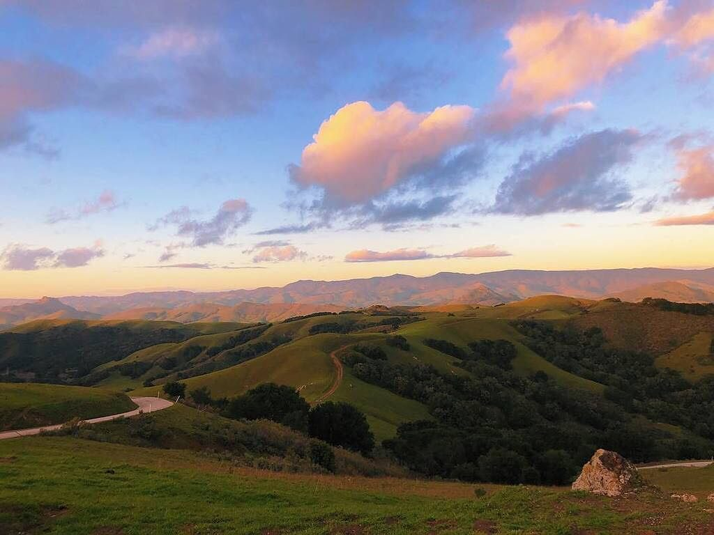 The rolling hills of Prefumo Canyon in San Luis Obispo with light clouds overhead. Photo by @beckyboersma_