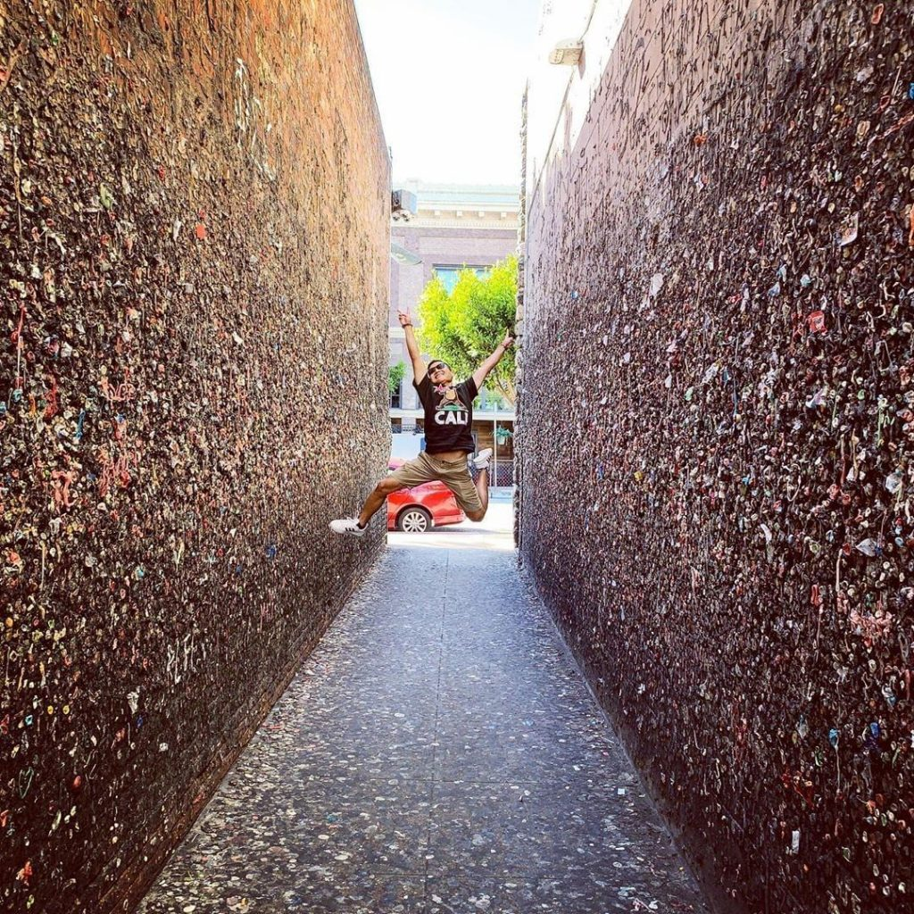 A jumping man in the middle of Bubblegum Alley in San Luis Obispo. Photo by @justparked