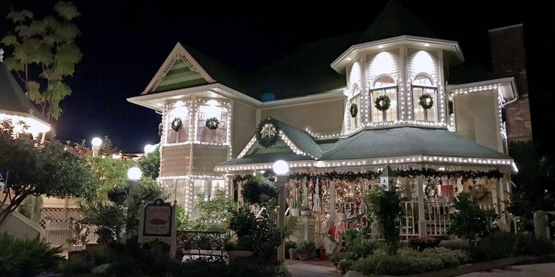 Apple Farm exterior on a dark night with holiday lights.