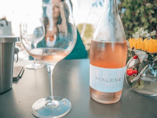 Glass and bottle of Malene rose wine in San Luis Obispo