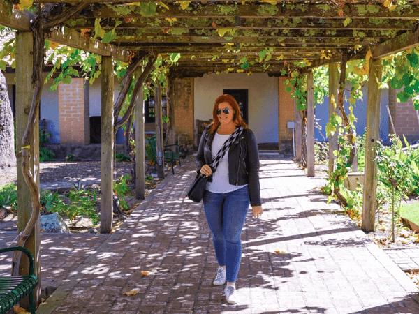 Kate in the garden area of San Luis Obispo de Tolosa.