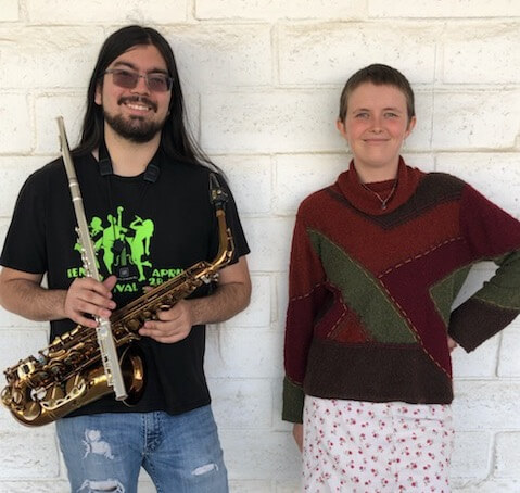 The Adam and Emily Jazz Duo, smiling with saxophone in hand.