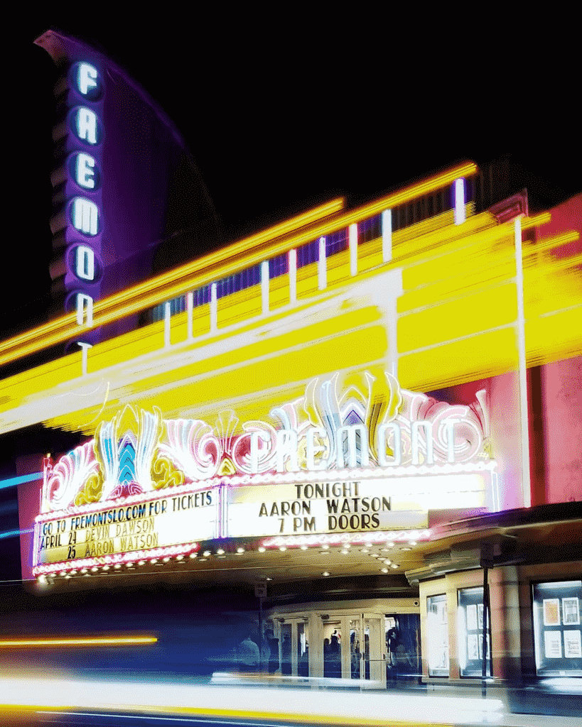 The Fremont Theater exterior with colorful light effects. Photo by @powlpow