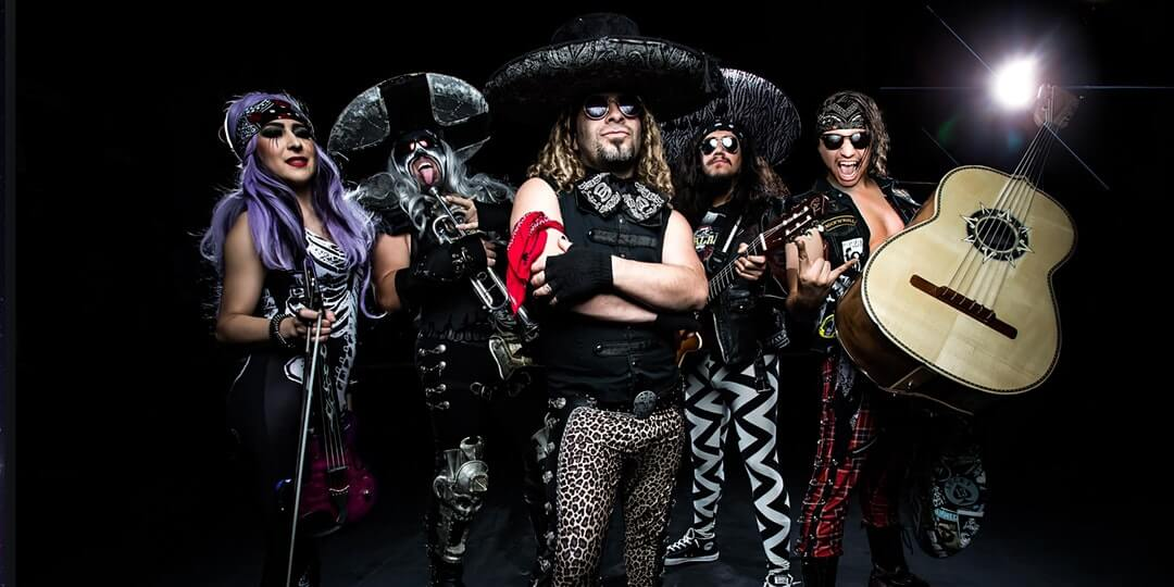 5 band members of Metalachi with sombreros and black clothing.