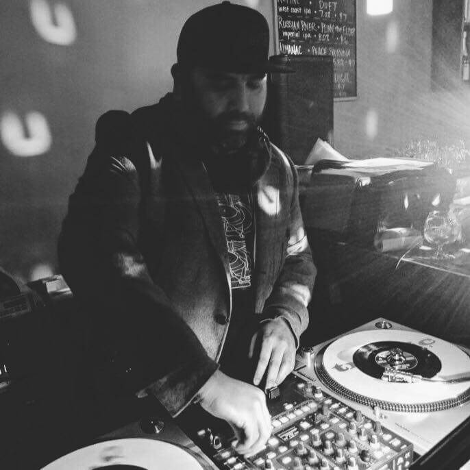 DJ Jason Perez on some turntables.