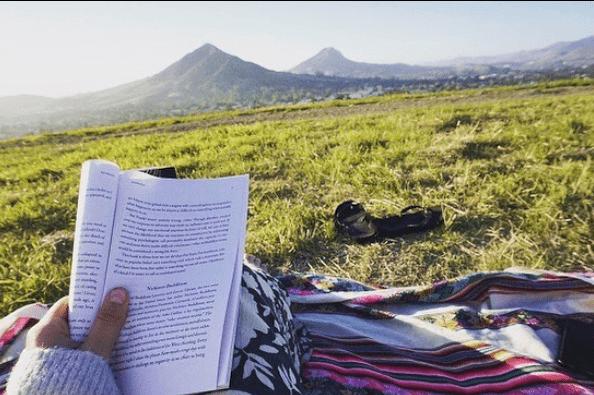 Person reading on Terrace Hill in San Luis Obispo