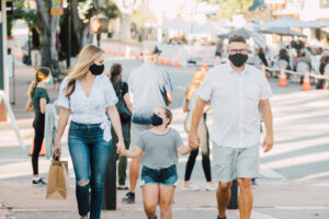 Family shopping downtown SLO with masks for safety